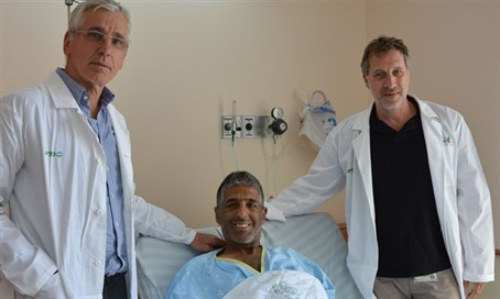 Medical team with the implant recipient