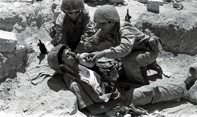 Israeli soldier gets first aid and drink of water, Six Day War