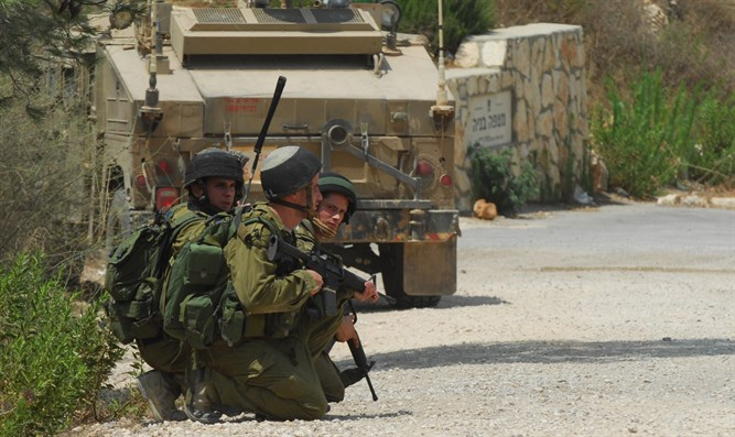 IDF soldiers crouch at Lebanon border during fire exchange
