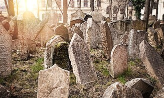 Prague: Headstones used as paving stones identified in central square