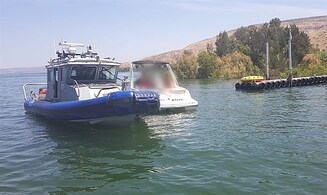 Watch: Police save boat from sinking on the Kinneret