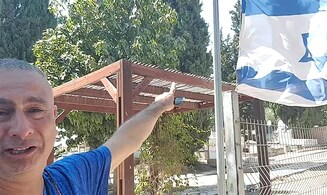 Father of murdered soldier Amit Ben Yigal lowers flag to half-mast