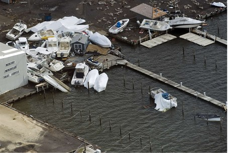Boats pile up at a marina where they washed a