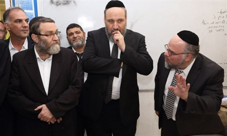 Moshe Gafni (second from left)