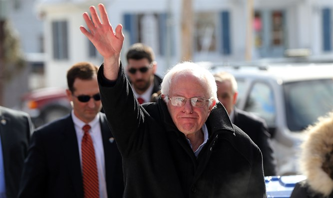 Sen. Bernie Sanders, waving on the day of the New Hampshire primary