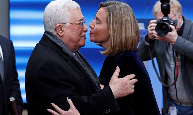 Mahmoud Abbas is greeted by EU foreign affairs chief Federica Mogherini