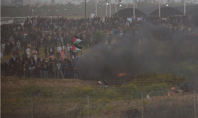 Violent rioters gather along Gaza border