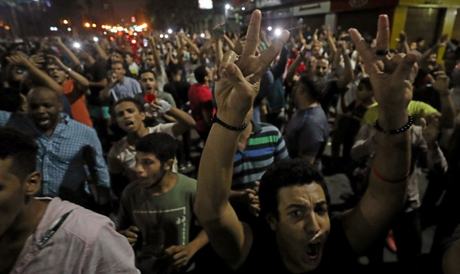 Protesters shouting anti-government slogans in Cairo