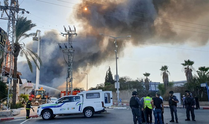 Israeli firefighters work to extinguish a fire at a factory in Sderot